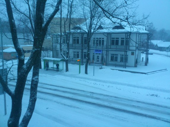 Snowy bus stop in the centre of town, Druskinikai, Lithuania.