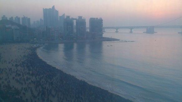 Thousands of people watching the sun rise on 2014, on Gwangalli Beach, Busan, South Korea