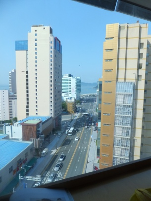 View from the breakfast room at Popcorn Hostel, looking down towards Haeundae Beach.